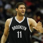 Brooklyn Nets center Brook Lopez (11) reacts against the Atlanta Hawks in the fourth quarter at Philips Arena. The Hawks defeated the Nets 101-87.