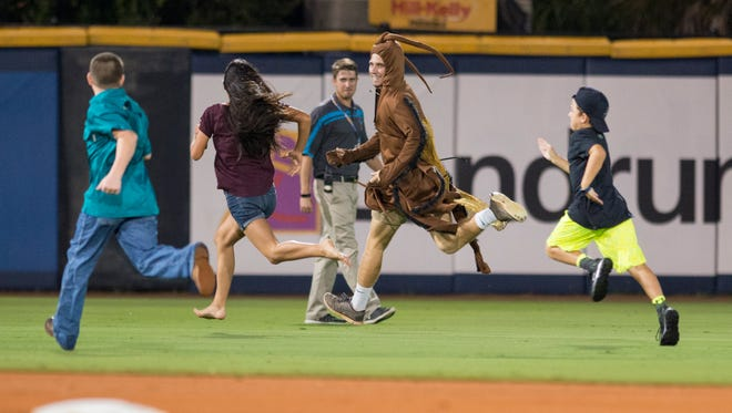 The roach tauntingly smiles at the children chasing him during the Mobile BayBears vs the Pensacola Blue Wahoos baseball game in Pensacola on Friday, August 11, 2017.  The kids came close, but the roach as always was just too fast.