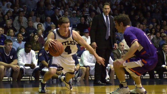 Butler and Evansville will play for the 119th time Saturday. Here, in a 2001 meeting, current Butler coach Brandon Miller drives against an Evansville defender.