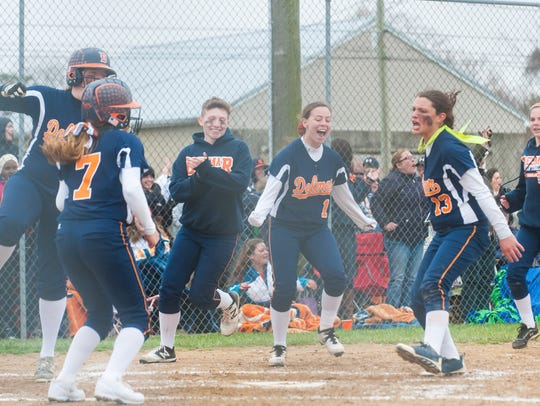 Delmar celebrates a home run by Shelby Murphy against