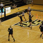 Freshman Miranda Watkins sets a ball during a match against Temple at The Venue at UCF on Sept. 27, 2015.