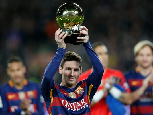 FC Barcelona's Lionel Messi, from Argentina, holds up his Ballon d'Or (Golden Ball) award as European Footballer of the Year prior the Spanish La Liga soccer match between FC Barcelona and Athletic Bilbao at the Camp Nou stadium in Barcelona, Spain, Sunday, Jan. 17, 2016. (AP Photo/Manu Fernandez)