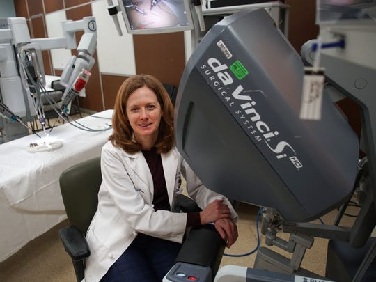 Dr. Jennifer Hagerty, director of Robotic Surgery, Division of Pediatric Urology, at Nemours/A.I. duPont Hospital for Children, shows off the da Vinci Surgical System, also known as Surgio.
