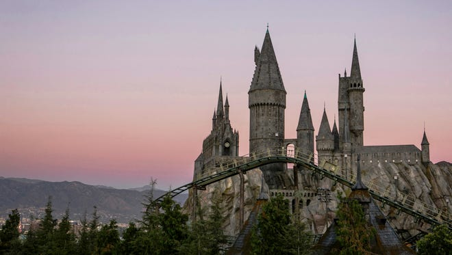 Hogwarts castle, with a view of Flight of the Hippogriff, Universal Studios Hollywood's first outdoor roller coaster.