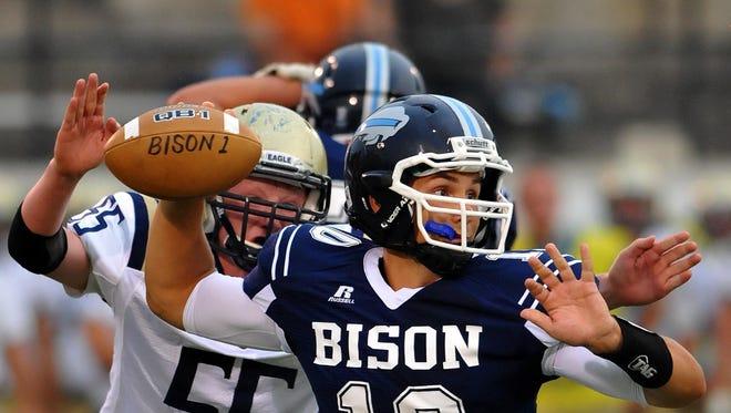 Great Falls High quarterback Kaden Sukut attempts a pass as Big Sky defender KJ Swanson closes in earlier in the season.