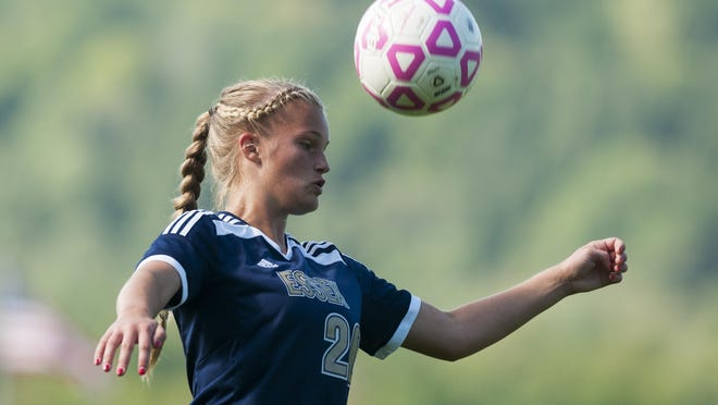 Essex's Megan Macfarlane (20) heads the ball during the girls soccer game between the Essex Hornets and the Mount Mansfield Cougars at MMU High School earlier this season in Jericho.
