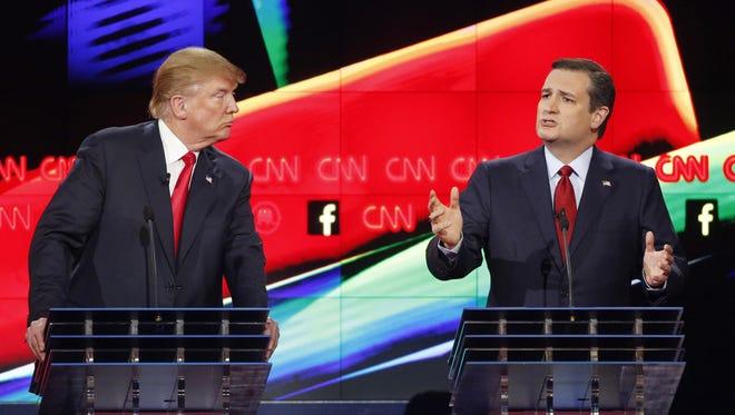 In this Dec. 15 photo, Donald Trump, left, watches as Ted Cruz speaks during the CNN Republican presidential debate at the Venetian Hotel & Casino in Las Vegas.