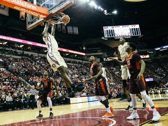 Dwayne Bacon (4) dunks the ball during Florida State's 93-78 win over Virginia Tech in Tallahassee, Fla. on Saturday, January 7, 2017.