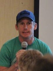 Triathlete Charlie Epperson talk at a running workshop in 2014. The Guam Running Club Summer Running Clinic will be held Saturday.