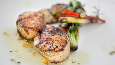 This spicy gem from the Breadfruit is diver scallops soaked in Appleton Jamaica Rum, then coated in a dry jerk rub before being seared in a cast-iron skillet.