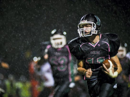 Fairfield's Michael Quealy charges through the rain to score a touchdown during the third quarter of a 2014 game against Hanover. The Green Knights won, 18-14. (Shane Dunlap -- GameTimePA.com)