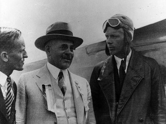 City leaders greet Charles A. Lindbergh, right, at Lunken Field on Aug. 6, 1927.