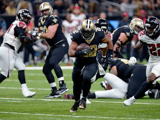 New Orleans Saints running back Mark Ingram (22) carries for a touchdown s Atlanta Falcons strong safety Keanu Neal (22) pursues in the second half of an NFL football game in New Orleans, Sunday, Dec. 24, 2017. (AP Photo/Bill Feig)