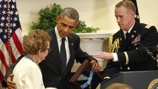 Helen Loring Ensign, 85, of Palm Desert, Calif., receives the Medal of Honor from President Obama on behalf of Army 1st Lt. Alonzo Cushing for conspicuous gallantry,  at the White House on Nov. 6, 2014. Cushing was awarded posthumously for his actions while serving as commanding officer of Battery A, 4th United States Artillery, Artillery Brigade, 2nd Corps, Army of the Potomac during combat operations in the vicinity of Cemetery Ridge, Gettysburg, Pa., on July 3, 1863.