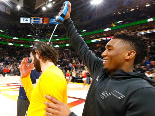 Utah Jazz's Donovan Mitchell, right, celebrates by