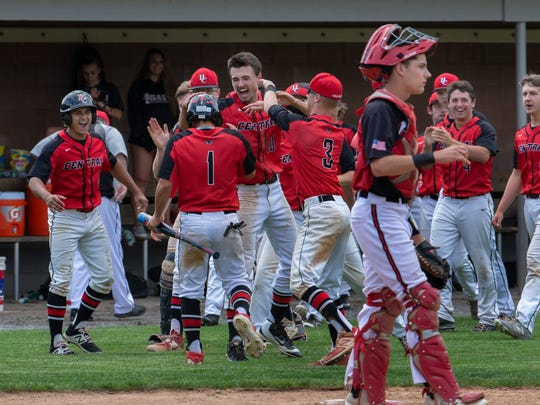 Hunterdon Central celebrates after their third run scored to give them a 3-1 lead. Hunterdon Central defeats Jackson Memorial 3-1 in NJSIAA Group IV semifinal baseball game at Rider University in Lawrenceville, NJ on June 5, 2018.