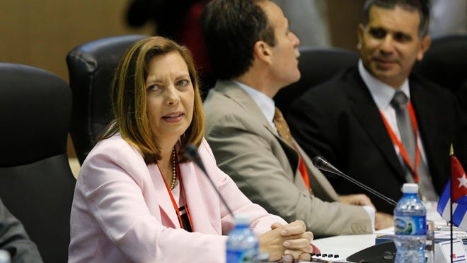 Ministry of Foreign Relations General Director for the United States, Josefina Vidal, and Cuban delegation members, sit across from U.S. delegates as they begin negotiations, in Havana, Cuba, Wednesday, Jan. 21, 2015. The highest-level U.S. delegation to Cuba in decades kicked off two days of negotiations Wednesday after grand promises by President Barack Obama about change on the island and a somber warning from Cuba to abandon hopes of reforming the communist government. (AP Photo/Desmond Boylan)