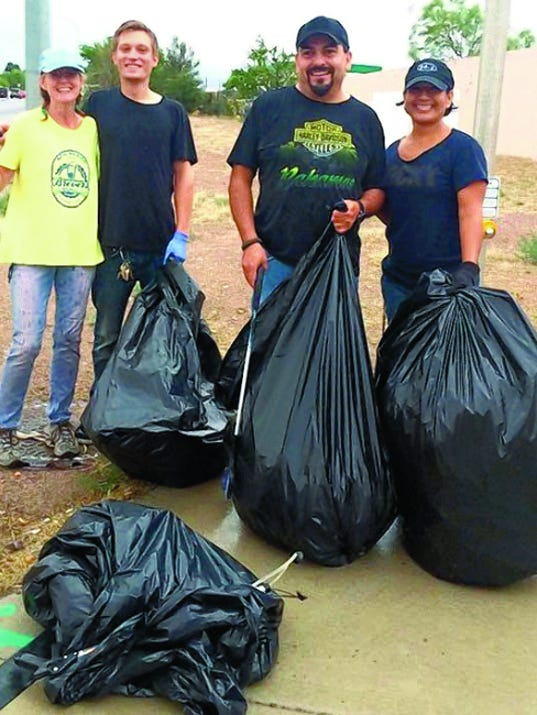 """Courtesy photo   Cruceño Cleanup founder Abbey Carver (right) enlists her father, Lee Carver, to help pickup garbage. """"You can even convince your family to come hang out with you while you slowly save the world,"""" she jokes."""