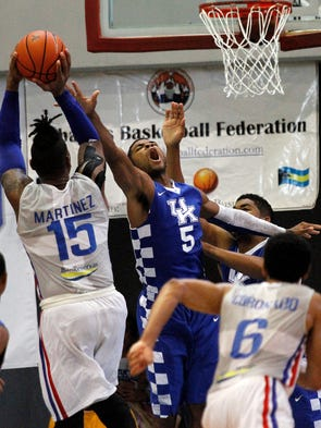Jack Michael Martinez scores the game-winning shot over Kentucky's Andrew Harrison during the team's exhibition game against the Dominican Republic national team in Nassau, Bahamas, August 17, 2014. Photo by Drew Fritz, Special to the Courier-Journal