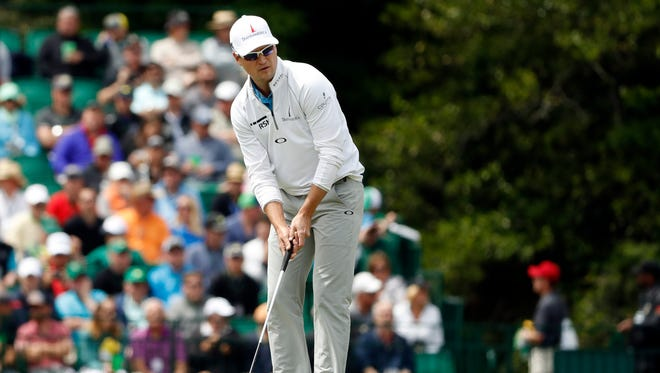 Zach Johnson putts on the 15th green during a practice round prior to the 2016 The Masters golf tournament at Augusta National Golf Club.