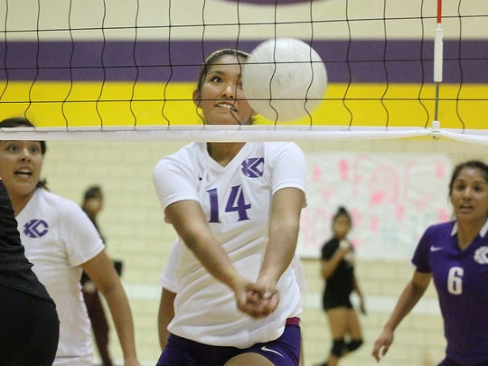 Kirtland Central's Nia Nelson returns the ball during a game against Gallup on Thursday at Kirtland Central High School.