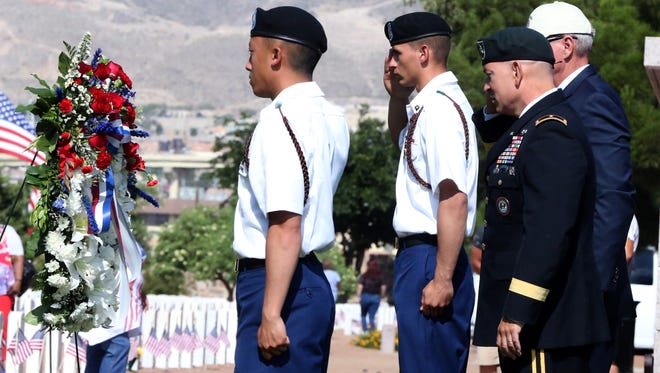 Brig. Gen. Kurt S. Crytzer, right, commanding general of Joint Task Force North, salutes during placing of the wreath at the Memorial Day ceremony at Fort Bliss National Cemetery on Monday. Crytzer was the keynote speaker at the ceremony.
