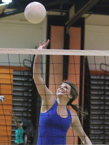 Christie Verschoor, photographed on Feb. 26, 2014, plays in a volleyball league at Hommocks Middle School in Larchmont as a way to keep fit.