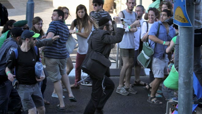 == ISRAEL OUT == Yishai Shlissel, an ultra-orthodox Jew, raises a knife during an attack in which he stabbed six people taking part in a Gay Pride parade in central Jerusalem on July 30, 2015.