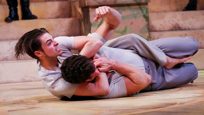 """Orlando, played by Rich Buchanan, gets the better of Charles the Wrestler, played by James Caudill, in a scene from Purdue Theatre's production of """"As You Like It"""" Tuesday, November 10, 2015, at Hansen Theatre in Pao Hall."""