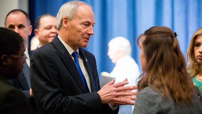 Arkansas Gov. Asa Hutchinson answers questions after a town hall event about Arkansas Works at Central Baptist College Tuesday, March 22, in Conway.