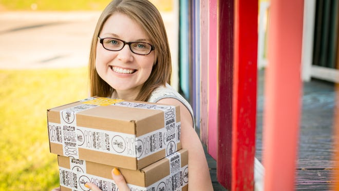 Central graduate Leitia McHugh runs her own online business from home selling parties in a box.