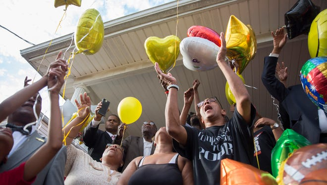 Christopher 2 X, peace and justice activist and longtime family friend of Dequante Hobbs Jr. and his family, lead community members in his balloon release  memorial. May 23, 2017.