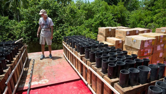 Eric Seemann, who works for Zambelli Fireworks, sets up the barge on Nonday, July 3, 2017, for the Fourth of July fireworks display that will be Tuesday night at the Naples Pier. Seemann has been in the fireworks business for around 44 years.