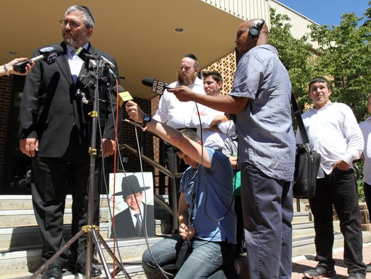 Lakewood Councilman Meir Lichtenstein tells the press authorities have found the body of Aaron Sofer, a 23-year-old Lakewood religion student who went missing during a hike on Friday in Jerusalem during a press conference in front of the Lakewood Township Municipal Court building in Lakewood, NJ Thursday August 29, 2014.  Staff photo Tanya Breen