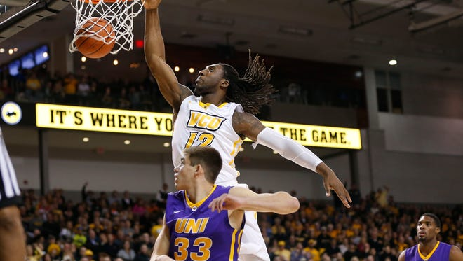 Dec 13, 2014; Richmond, VA, USA; Virginia Commonwealth Rams forward Mo Alie-Cox (12) shoots the ball in front of Northern Iowa Panthers guard Wyatt Lohaus (33) in the first half at Stuart Siegel Center. Mandatory Credit: Amber Searls-USA TODAY Sports