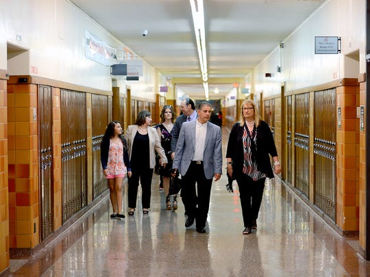 Lansing Mayor Virg Bernero and Lansing School District Superintendent Yvonne Caamal Canul walk the halls of Sexton High School during the first day of school for the district Tuesday, Sept. 6, 2016.