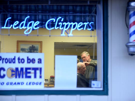 Gary Ford cuts Dave Hamilton's hair on Tuesday, March 28, 2017 at Ledge Clippers in Grand Ledge. This is Ford's last week at the barbershop. He has been a barber for more than 50 years.