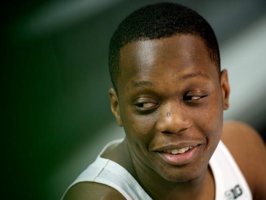 Michigan State guard Cassius Winston smiles during