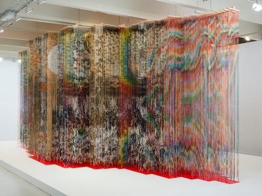 """Nick Cave, """"Architectural Forest,"""" 2011, bamboo, wood, wire, plastic beads, acrylic paint, screws, fluorescent lights, color filter gels, and vinyl, 136x372x192."""" Courtesy of the artist and Jack Shainman Gallery, New York, in collaboration with the Fabric Workshop Museum, Philadelphia. ©Nick Cave."""