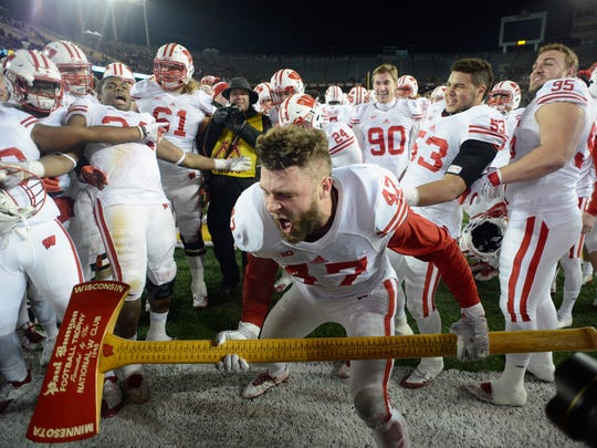 Badgers linebacker Vince Biegel wields the Paul Bunyan Axe after UW's last victory at TCF Bank Stadium in 2015.