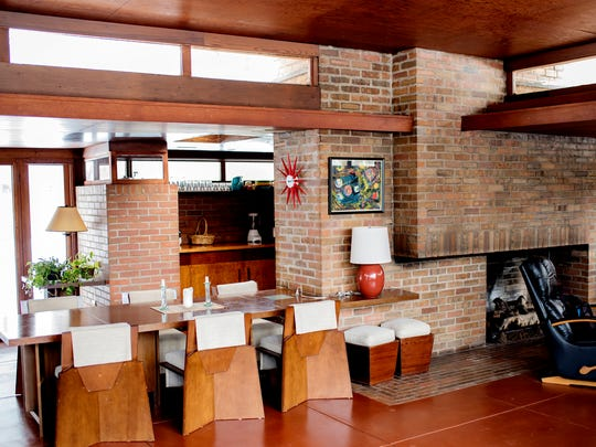 A view of the dining table in the main living area inside the Goetsch-Winckler House on Thursday, Feb. 15, 2018, in Okemos. The home was built in 1940 and was designed by architect Frank Lloyd Wright.