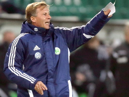 FILE - In this Oct. 31, 2012 file photo Wolfsburg's assistant coach Andries Jonker reacts during the DFB'Cup soccer match between VfL Wolfsburg and FSV Frankfurt at the Volkswagen Arena in Wolfsburg, Germany, Jonker is said to become the new coach of Bundesliga soccer club VfL Wolfsburg after coach Valerien Ismael was fired, Sunday, Feb. 26, 2017. (Jens Wolf/dpa via AP)