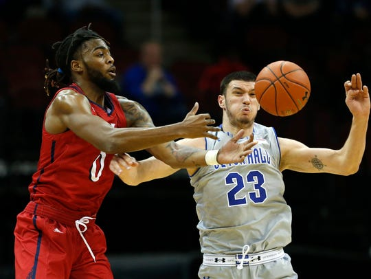 NJIT forward Abdul Lewis (0) and Seton Hall Pirates forward Sandro Mamukelashvili (23) battle for a rebound