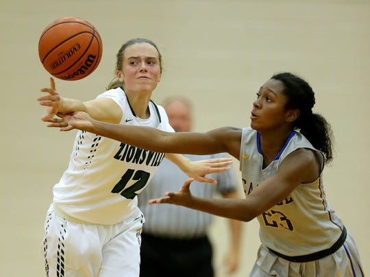 Zionsville's Erin Patterson (12) and Carmel's Jasmine McWilliams may face off in Saturday's regional final.