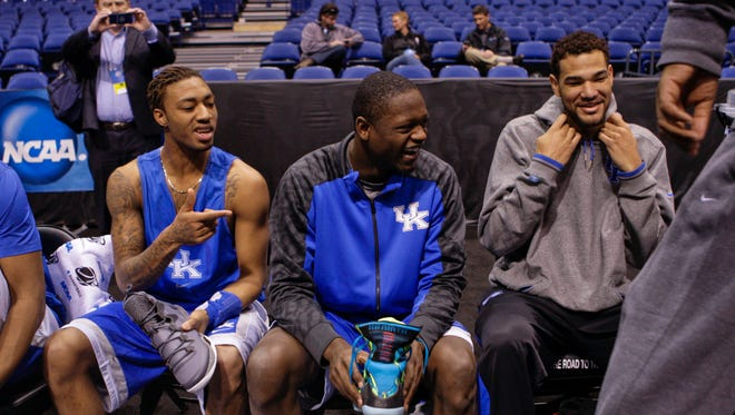 Kentucky's James Young, Julius Randle and Willie Cauley-Stein prepare to practice in Indianapolis at the NCAA Sweet 16 Thursday before Friday's game against Louisville.  March 27, 2014