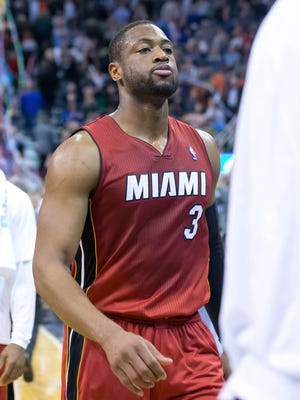 Heat shooting guard Dwyane Wade, shown Feb. 8, sat Wednesday with a foot injury and may be out for the All-Star Game.