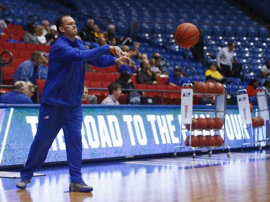 """Florida Gulf Coast head coach Joe Dooley passes the ball Monday, March 14, 2016 at the University of Dayton Arena in Dayton, Ohio. The Florida Gulf Coast men's basketball team met with the media and hosted practice in preparation to take on Fairleigh Dickinson University (Teaneck, N.J.) Tuesday. The First Four """" a play-in game to the NCAA Tournament """" the winner will face top seeded University of North Carolina in Raleigh, N.C. Thursday."""