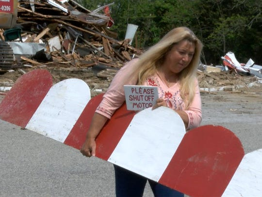Bonnie Leigh, Brick, holds some items she found amongst