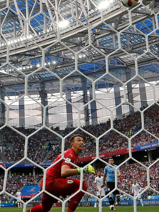Russia_Soccer_WCup_Match_Moments_Day_20_Photo_Gallery_84001.jpg