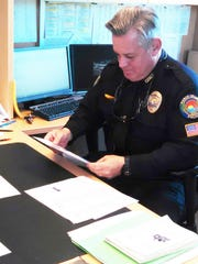 Police chief Al Schettino, named in January to the top job, reviews staffing requirements for the holidays at his desk at the Marco Island Police Department headquarters.